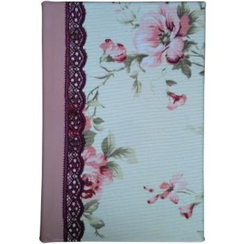 Biblie mijlocie aurita pe margini hand-made, material textil floral crem-visiniu, cu piele roz la cotor.